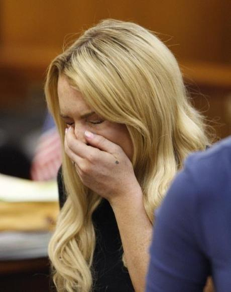 Actress Lindsay Lohan sneezes while appearing in court during a probation status hearing relating to her August 2007 no contest pleas to two counts each of DUI and being under the influence of cocaine, along with a reckless driving charge, at the Beverly Hills Municipal Courthouse, in Beverly Hills, California on July 6, 2010.   UPI/David McNew/Pool Photo via Newscom