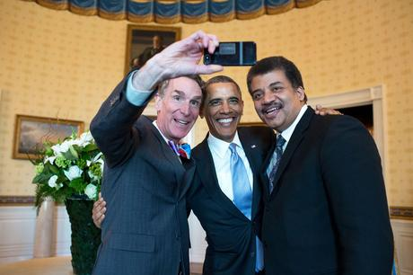 President Barack Obama poses for a selfie with Bill Nye, left, and Neil DeGrasse Tyson in the Blue Room prior to the White House Student Film Festival, Feb. 28, 2014. (Official White House Photo by Pete Souza) This official White House photograph is being made available only for publication by news organizations and/or for personal use printing by the subject(s) of the photograph. The photograph may not be manipulated in any way and may not be used in commercial or political materials, advertisements, emails, products, promotions that in any way suggests approval or endorsement of the President, the First Family, or the White House.