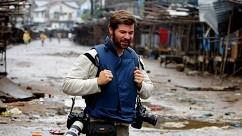 Handout photo of Getty Images photographer Chris Hondros walking through the streets in Liberia