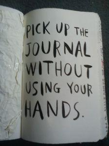 Pick up the Journal without using your hands
