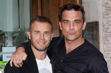LONDON, ENGLAND - AUGUST 26: (UK TABLOID NEWSPAPERS OUT) L-R Gary Barlow and Robbie Williams pose before an interview with Chris Moyles on Radio 1 held at The Radio 1 Building on August 26, 2010 in London, England. (Photo by Dave Hogan/Getty Images)