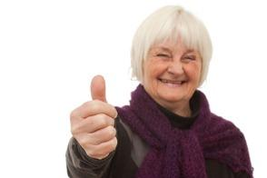 Success - older woman giving you the thumbs up