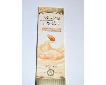 Lindt Weisse Chocolade mit Mandel-Nougat und Mandel-Splittern, mit hellem Orangen-Trüffel und mit Haselnuss-Nougat und Waffel-Stückchen