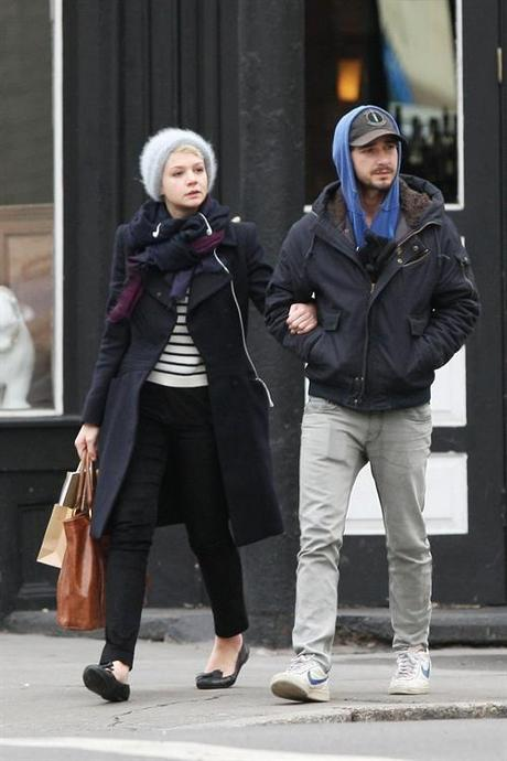 38195, NEW YORK, NEW YORK - Tuesday March 2, 2010. Shia Labeouf shares a tender kiss with girlfriend Carey Mulligan while strolling through NYC together. Shia is seen wearing a hooded sweatshirt and gray jeans (with what looks like a ripped pocket!) while his adorable Oscar-nominated girlfriend Carey opted for a furry beanie and navy blue coat. Carey is seen holding canvas handbag and a notebook in her brown paper bag. Photograph: PacificCoastNews.com
