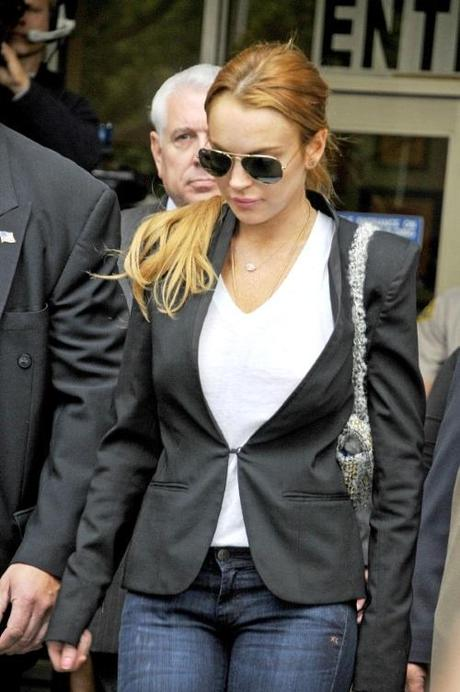 46506, LOS ANGELES, CALIFORNIA - Friday October 22, 2010. Lindsay Lohan leaves an LA courthouse after Judge Elden Fox ruled that she will remain in rehab until Jan 3. THe modestly dressed 24 year old actress - who violated her probation in her DUI cased due to a failed drug test - will remain in rehab at the Betty Ford Center in Racho Mirage, California. Photograph:  Koi Sojer, PacificCoastNews.com