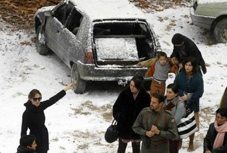 Actress Angelina Jolie (R) directs actors during the filming of her yet untitled directorial debut in Budapest November 8, 2010. Jolie is directing her first feature film about a Serbian man and Bosnian woman who meet on the eve of the 1992-95 Bosnian war. REUTERS/Laszlo Balogh (HUNGARY - Tags: ENTERTAINMENT)