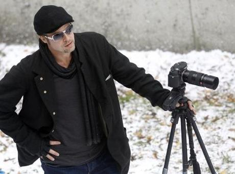 Actor Brad Pitt stands next to a camera on the set of actress Angelina Jolie's yet untitled directorial debut in Budapest November 8, 2010. Jolie is directing her first feature film about a Serbian man and Bosnian woman who meet on the eve of the 1992-95 Bosnian war. REUTERS/Laszlo Balogh (HUNGARY - Tags: ENTERTAINMENT)