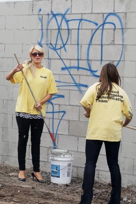47693, LOS ANGELES, CALIFORNIA - Friday November 19, 2010. Paris Hilton, wearing a diamond Chanel necklace, arrives to do community service with the Hollywood Beautification Team. The socialite and heiress is seen trading her leather jacket and lowcut striped top for a standard yellow t-shirt featuring the organization's logo. Hilton helped other volunteers paint over graffiti found on the walls, some featuring graffiti with MS-13 markings, allegedly by the Mara Salvatrucha 13, gang. Hilton was being documented by several cameras throughout her community service work, and also never changed out of her off her black stiletto heels. She was seen several hours later signing a document that reportedly confirmed her community service hours. Before leaving, Hilton was assisted with putting on a band-aid on her finger. The heiress looked to be in good spirits after her day's work, not seeming to care that she had paint stains on her pants and heels! Photograph: Sam Sharma / Nate Jones,  PacificCoastNews.com