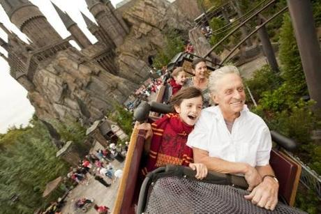 Academy award-winning actors Michael Douglas and wife Catherine Zeta-Jones, along with their children Dylan, 10, and Carys, 7, ride the Flight of the Hippogriff over The Wizarding World of Harry Potter and past Hogwarts Castle at Universal Orlando Resort November 27, 2010. Fans of the Harry Potter books and films, the family also sampled Butterbeer, got fitted for wands at Ollivanders and toured Hogwarts Castle while on vacation at Universal Orlando over the Thanksgiving holiday.  REUTERS/Universal Orlando Resort/Matt Stroshane/Handout (UNITED STATES - Tags: ENTERTAINMENT) NO SALES. FOR EDITORIAL USE ONLY. NOT FOR SALE FOR MARKETING OR ADVERTISING CAMPAIGNS. THIS IMAGE HAS BEEN SUPPLIED BY A THIRD PARTY. IT IS DISTRIBUTED, EXACTLY AS RECEIVED BY REUTERS, AS A SERVICE TO CLIENTS