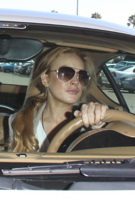 44906, LOS ANGELES, CALIFORNIA - Tuesday September 14, 2010. A smiling Lindsay Lohan and her assistant Eleonore leave the Santa Monica courthouse and drive off in a white Porsche. Photograph:  David Tonnessen, PacificCoastNews.com