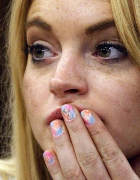 Hollywood starlet Lindsay Lohan has an expletive written on her middle finger during a probation status hearing at the Beverly Hills Municipal Courthouse, in Beverly Hills, California on July 6, 2010.   UPI/David McNew/Pool Photo via Newscom