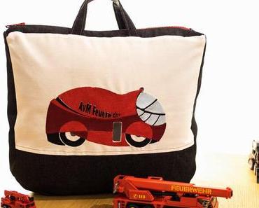 Eigene Motive sticken – Feuerwehrauto auf Spielzeugtasche