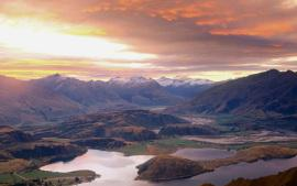Sunset over Lake Wanaka. Mt. Aspiring in distance from Mt. Roy. Central Otago. New Zealand.